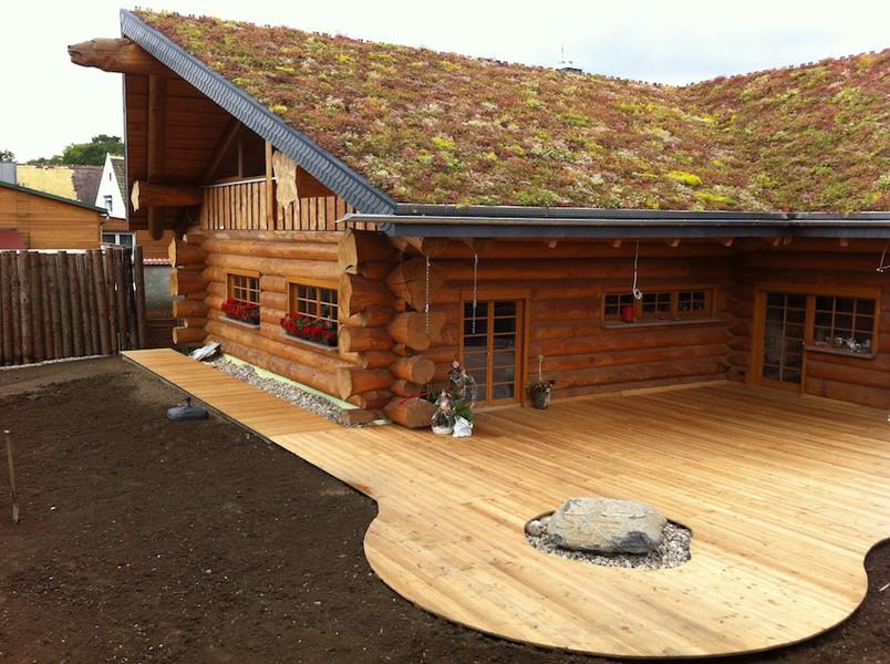 Blockhaus naturstammhaus aus rundholz midsummer cottage for Holzblockhaus modern